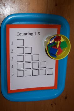 Counting tiles 1-5. I like the interactive feature...you could make 4-6 of these, and have it out at the math center.