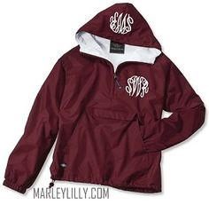Monogrammed Maroon Pullover Rain Jacket with tan embroidery. CPE monogram in Sydney font on chest only. Size medium.