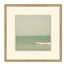 Personal seaside photo enlarged and framed in Master bedroom over sofa.