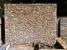 Irregular uncoursed rubble work in reclaimed Bargate Stone