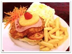 Chef's Speciality Dish of the Week - Hawaiian Crumbed Chicken Burger - A fresh bun filled with a crumbed chicken fillet topped with ham, pineapple, lettuce and tomato served with golden fries on the side @R49.95 available unti Saturday the 9th of March 2013 (not available on Sundays) March 2013, Lettuce, Hawaiian, Hamburger, Fries, Pineapple, Dishes, Chicken, Ethnic Recipes
