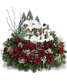 The Teleflora Winter Wonder Bouquet has the newest Collectable Thomas Kincade scene with a snow covered house, large snowman, trees, and children at play. The scene is nestled in a bed of winter greens, roses, berries, baby's breath, and pine cones.