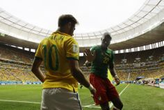 Brazil beats Cameroon 4-1, reaches 2nd round - Cameroon's Allan Nyom tries to shake hands with Brazil's Neymar after pushing him to the ground in the corner during the group A World Cup soccer match between Cameroon and Brazil at the Estadio Nacional in Brasilia, Brazil, Monday, June 23, 2014. (AP Photo/Natacha Pisarenko)
