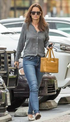 Katie Holmes looked chic and lovely in a classy casual ensemble including skinny blue jeans and a grey button down shirt as she took her daughter Suri Cruise for an evening meal at a trendy restaurant in Agoura, California on April 10, 2016. Suri seemed to have come straight from her dance class as she was still in her dance attire including pink leotard under grey jacket.