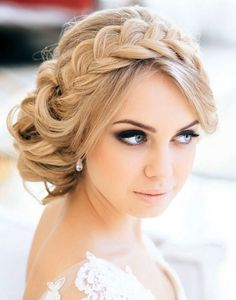 Updo wedding hairstyle with large plait. Go with a braid for your bridal hair when you do your next updo.