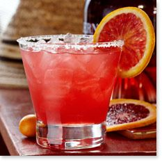 Tommy Bahama Recipe  BLOOD ORANGE MARGARITA 2 parts gold tequila 1 part Solerno® Blood Orange Liqueur ½ part fresh blood orange juice 1 part scratch sour (see recipe below)  Combine all ingredients in a Boston shaker, add ice and shake vigorously until chilled. Strain over ice into a double rocks glass rimmed with salt and garnish with a blood orange wheel.
