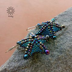 Starfish sewn from Japanese TOHO seed beads and Miyuki drop in shiny metallic blue-violet color with iridescent reflections and kerosene iridescent blue-green color, hypoallergenic metal components in a rhodium finish.