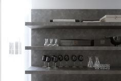 Modulnova CONCEPT line kitchen. Close up on concept laminate (stone clad/veneered look) wall panels and shelves