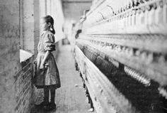 A child textile worker, circa. 1900.