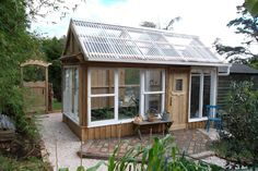 A greenhouse made from recycled windows!