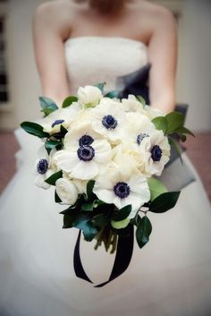 Anemone bouquet   BB Shots Photography   see more on: http://burnettsboards.com/2014/12/black-white-winter-wedding/