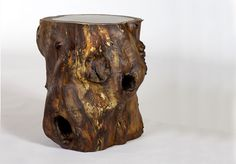 The Gnarly Tree Stump Table is a truly unique piece. Naturally gnarly hollowed Walnut stump with frosted acrylic top, lighted from the inside. Dimensions: 20″ D x 20″ H   Browse our other side and occasional tables.