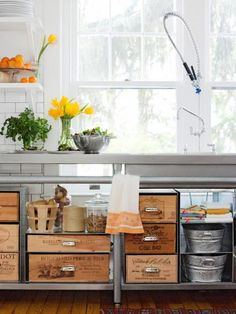 Stylish crates  Add drawer pulls to inexpensive wooden crates to make them easier to pull out from shelves.