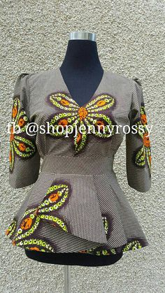 Make a statement with this beautiful one of a kind African print peplum Top. Pair with skirt or pant for any occasion and look elegant. Item details: African print 100% vlisco cotton Wax V neck line. Full linning with cotton Zipper Hook and eye. Puffy sleeves up to 18 inch 2.5 inch waist bind. Full flare bold pleated peplum.   You may like the print in skirt, check it out here... https://www.etsy.com/ca/listing/517839582/african-maxi-skirt-ankara-high-waist   Ple...