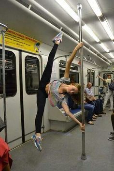 Pole dancing anywhere. .including the subway