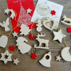 Christmas Collection Handmade Wooden Decorations  Christmas Edition offers beautiful handmade decorations for the Festive Season in various designs and colours. Fourteen designs in natural colours will brighten up your Christmas Tree. We only use high Quality woods such as mountain maple, pinewood, spruce wood and cherry wood. The whole production is Hand made, including magical branded gift wrapping from Choralis Art.  Sold separately or as a Set of 14.  #christmasdecorations… Handmade Decorations, Christmas Decorations, Traditional Christmas Tree, Wooden Decor, Handmade Wooden, Wood Art, Vintage Christmas, Woods, Festive
