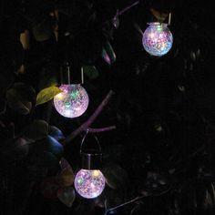 Lot de trois suspensions solaires LED Color Ball, référence 3012234 - Lampes décoratives pour l'extérieur : guirlandes lumineuses, lampes solaires à découvrir chez Luminaire.fr !