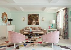Pastel living room with mint green wall colors, vintage mink brown velvet sofa, turquoise blue lamp on white lacquer end table, vintage pink chairs