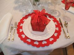 Valentine's table - could use a punch to punch hearts if these placemats are not available