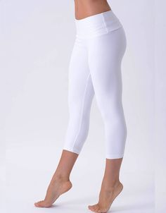 Style and fierce come together with these airy white yoga leggings. Hitting mid-calf, these stretchy White Yoga Leggings hug the body without ever riding up, no matter how much you pretzel your body i More
