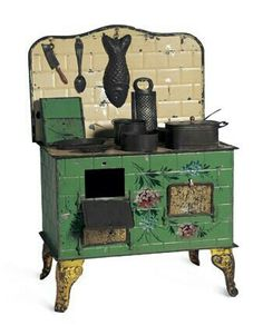 Early stove from miniature kitchen set. Late 19th century