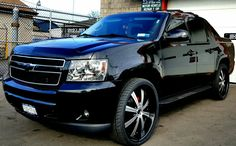 """2009 Chevy Avalanche custom with 26"""" rims"""