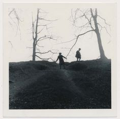 Vintage photo silhouetted figures