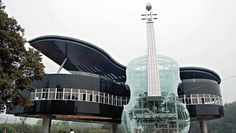 The Piano House located in Huainan City, An Hui Province, China. It contains a transparent violin and a piano building. Inside the violin, there is staircase toward the piano house upstairs.