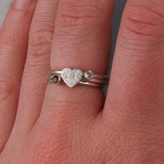 kids  initials and birth stone ring. So sweet. I like it for a mom ring