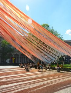 Dynamic pastel ribbons ripple down into the the traditional Cortile d'Onore courtyard of the Università degli Studi di Milano, creating an effervescent curtain suspended in space and time. The translucent installation, titled Invisible Borders, was designed by MAD Architects for the 2016 Milan Design Week