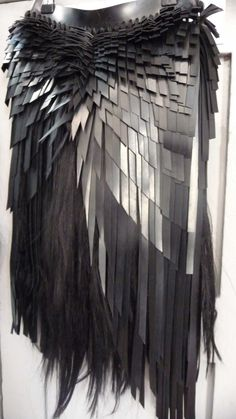Hair skirt with contrasting black textures; textiles for fashion; alternative materials; bird-inspired fashion design detail