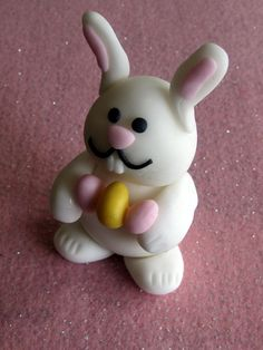 Easter white Fondant bunny with easter eggs by cakeascanvas