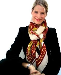 Fold your scarf/GM in the basic bias, then place around your neck as shown:  Put your hand through the loop you have created and pull one scarf end through: Op