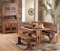 Rustic Oak Breakfast Nook is a Great Place to Start Your Day with Family. Stone Slate Tile Accents incorporate American Southwest-style with Carved Details, Colorful Slate Tiles & Exposed Wood Joints. Sturdy & Functional is the Rectangular Double Pedestal Table with Trestle & Plank Wood Top with Storage Shelf at the Corner Seat & inside Corner Bench. Comfortably Seats Six.http://www.vafurnituremarket.com/item.aspx?itemid=-1159630070&itemnum=0219T%2BBL%2BBS%2BSB-RO
