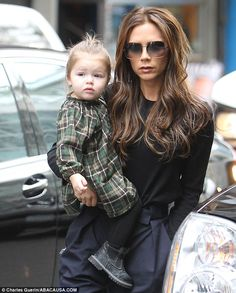 Time for fun: Victoria Beckham brings her daughter Harper shopping at FAO Schwarz in New York