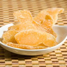 You've probably passed by this item thousands of times in your supermarket's produce department or baking aisle. Crystallized ginger – dried slices of natural ginger root, cured and coated in sugar… Ginger Uses, Snack Recipes, Cooking Recipes, Snacks, Cooking Tips, Free Recipes, Ginger Slice, Finger Food Appetizers