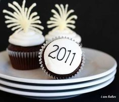 I wanted to share a few of my New Years Eve ideas from the last couple years.  If you plan on making any you can easily modify the date to reflect the current years festivities! New Years Eve Cupcakes Fun and easy tutorial on how to make the sparkly fireworks. New Years Eve Petite Fours These were
