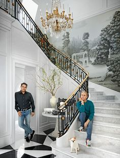 Johnson and Blandino in the entry hall staircase