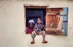 Small boy and family in the Volta region of Ghana, West africa