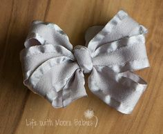 A simple yet adorable Hair Bow or Headband Clip made from Ruffle Ribbon!  This…