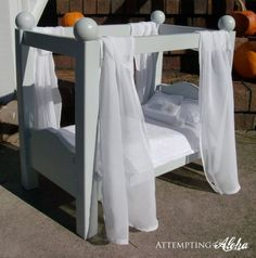 Inspired by designs from Ana White and a doll bed available from Pottery Barn Kids, this adorable DIY was born. A full supply list and tutorial are available at Attempting Aloha. LINK: Attempting Aloha: DIY Canopy Doll Bed – It's Done! American Girl Furniture, Girls Furniture, American Girl Doll Bed, Barbie Furniture, Dollhouse Furniture, Furniture Plans, American Girls, Furniture Websites, Modern Furniture