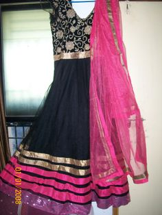 Floor touch anarkali suit in black color with neon pink duppatta.