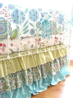 Love that the patterns don't match, but still go well together! Love the ruffled bed skirt!