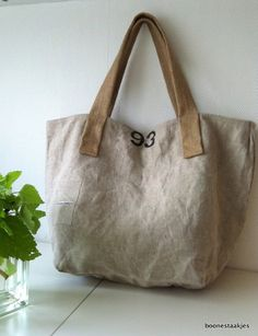 Upcycled postbag, tote, weekender.    This bag is made from upcycled original Dutch postbag 93 canvas, (fabric has used appearance).    Jute handles.    Very roomy, 5 pockets and a keyholder inside.    Closed with a strong zipper.    Lined with home decorating fabric in matching colours.    Size W 56 cm / 22, H 36 cm / 14, square bottom 28 x 28 cm / 11 x 11    Straps drop: 23 cm / 9 , total lenght: 55 cm / 21.      Thanks for visiting BOONESTAAKJES