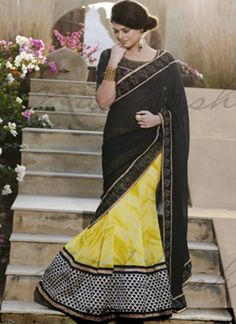 Yellow Scutt with Black Pallu highlighting saree http://www.angelnx.com/Sarees