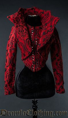 A beautiful thick red and black cotton brocade material jacket made for all evil and vampire queens out there. The pattern is woven in two layers. The collar is sturdy and stands up on its own.