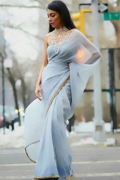 A subtle dusk blue chiffon sari with faux fur trim, paired with a matching suede corset top & detachable pearl embellishment. A classy, sophisticated display of the sari. Sexy Party Dress, Sexy Dresses, Evening Dresses, Fashion Dresses, Dresses 2016, Prom Gowns, Dress Prom, Fashion Clothes, Party Dresses