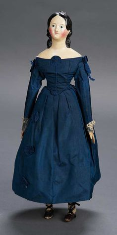 Doll,Germany,circa 1850. She's wearing an original navy blue taffeta gown,undergarments,stockings,shoes.