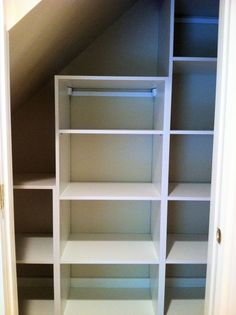 Built In Closet Walls angled ceiling | Sloped Ceiling Linen Storage in White | California Closets