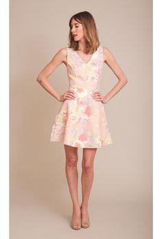 A short pink floral-printed bridesmaid dress from @lovelybridal | Brides.com